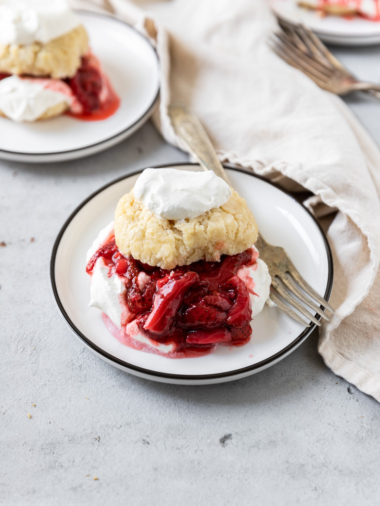 A roasted strawberry shortcake on a plate