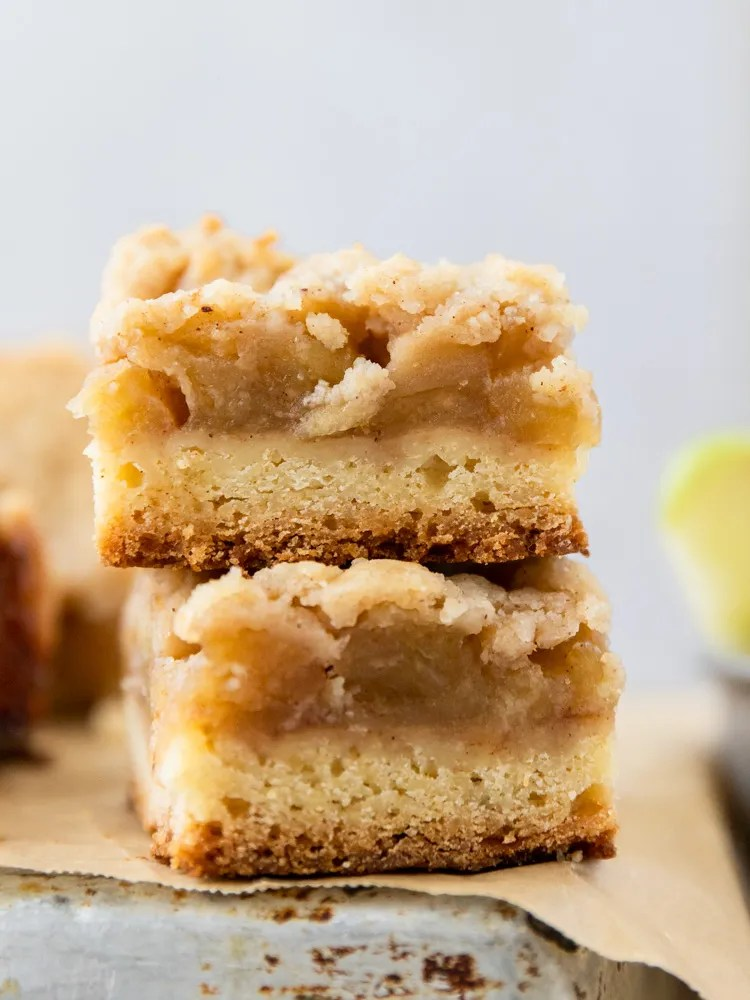 Two apple crumble bars stacked on top of each other