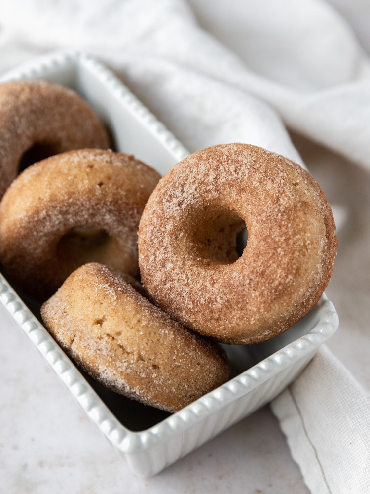 Baked donuts laying in a pan