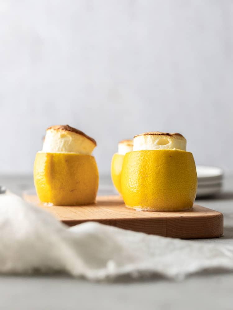 Three lemon soufflés sitting on a platter
