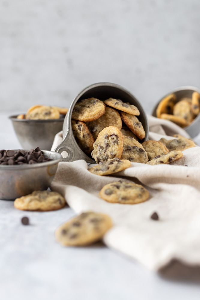 A straight on shot of a tipped over cup of cookies