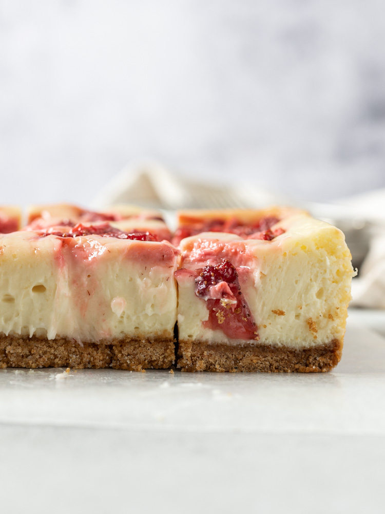 A side view of roasted strawberry cheesecake bars
