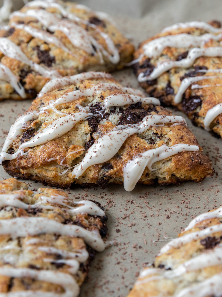 an up close shot of a chocolate chip cream cheese scone.