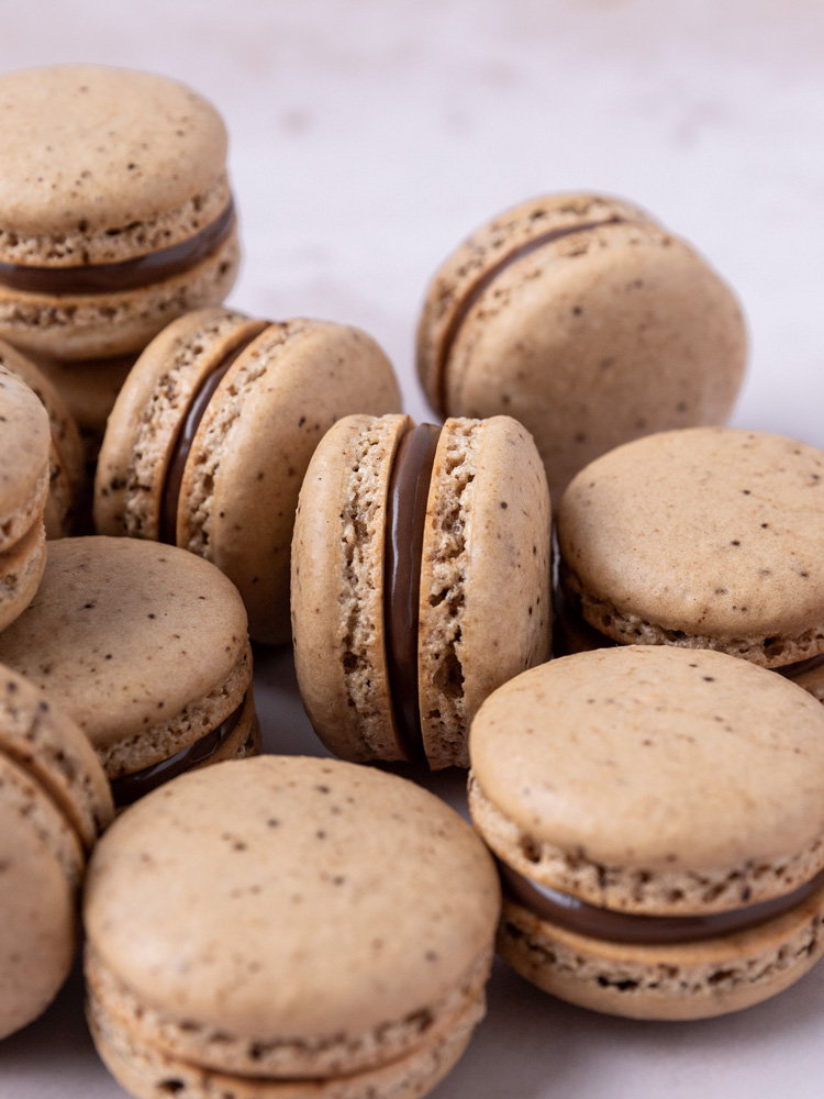 A pile of coffee nutella macarons