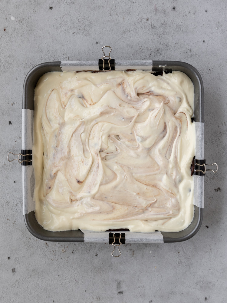 the cheesecake swirled brownies before being baked