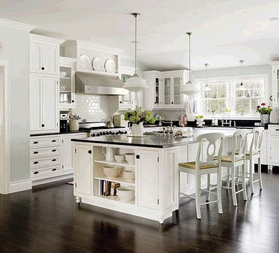 Bright, white kitchen cabinets accented by a spash of color in this Ashburn, VA home kitchen renovation and remodel.