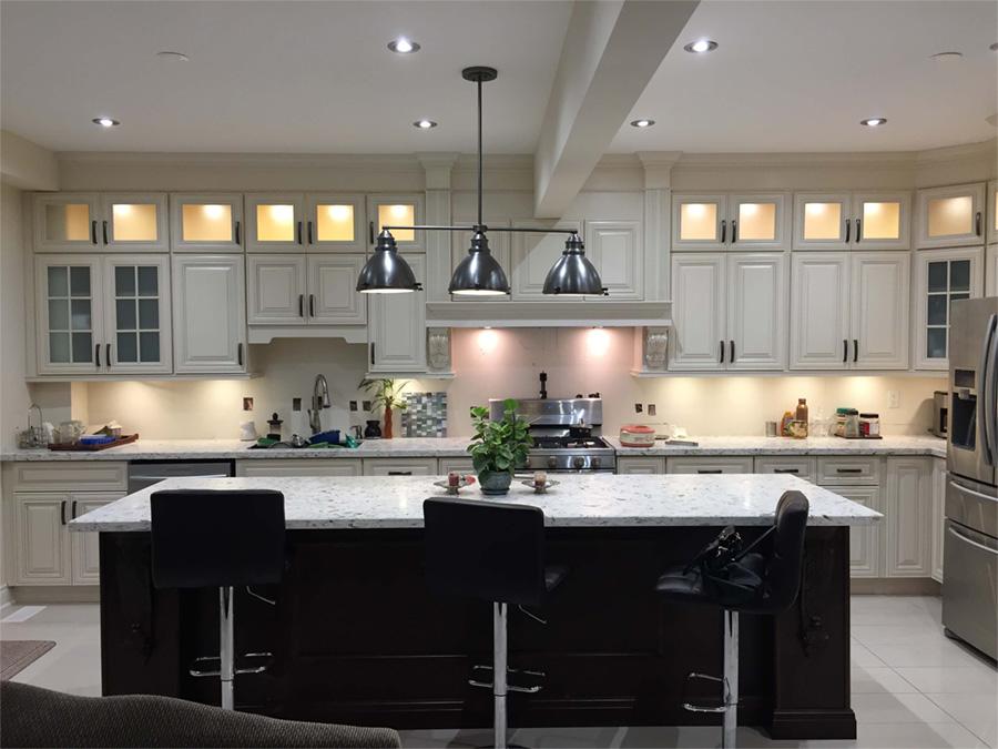 Kitchen wide view, island and custom lighting