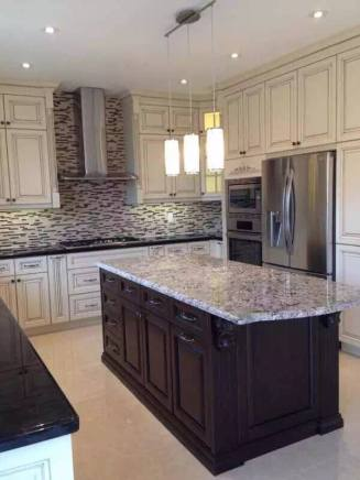 Full kitchen renovation with custom cabinets, lighting, countertops and backsplash