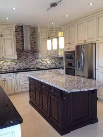 Full kitchen renovation with custom cabinets, lighting, countertops and backsplash