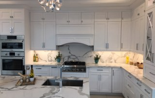 Quartz counter-top white shaker kitchen cabinets