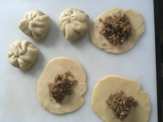 2. Fold dough over filling, so they resemble little pouches