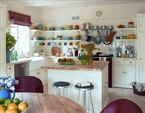kathryn n ireland kitchen open shelving purple accents wicker chairs roman shade butcher block countertops counters table white cabinets