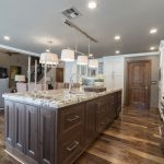 Kitchen Remodel With Large Granite Island And Real Wood
