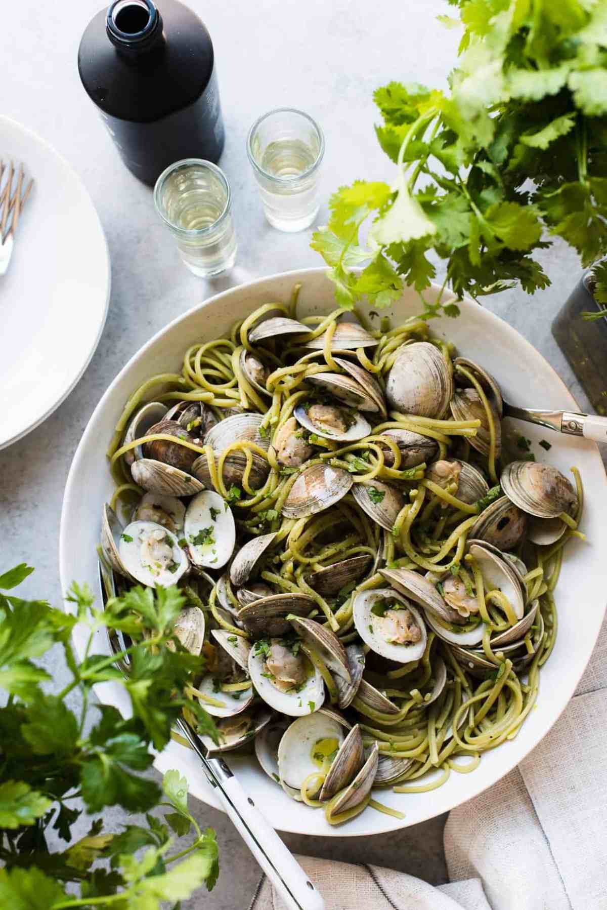 Linguine with Clams in Sake Red Chili Sauce in serving bowl with cilantro.