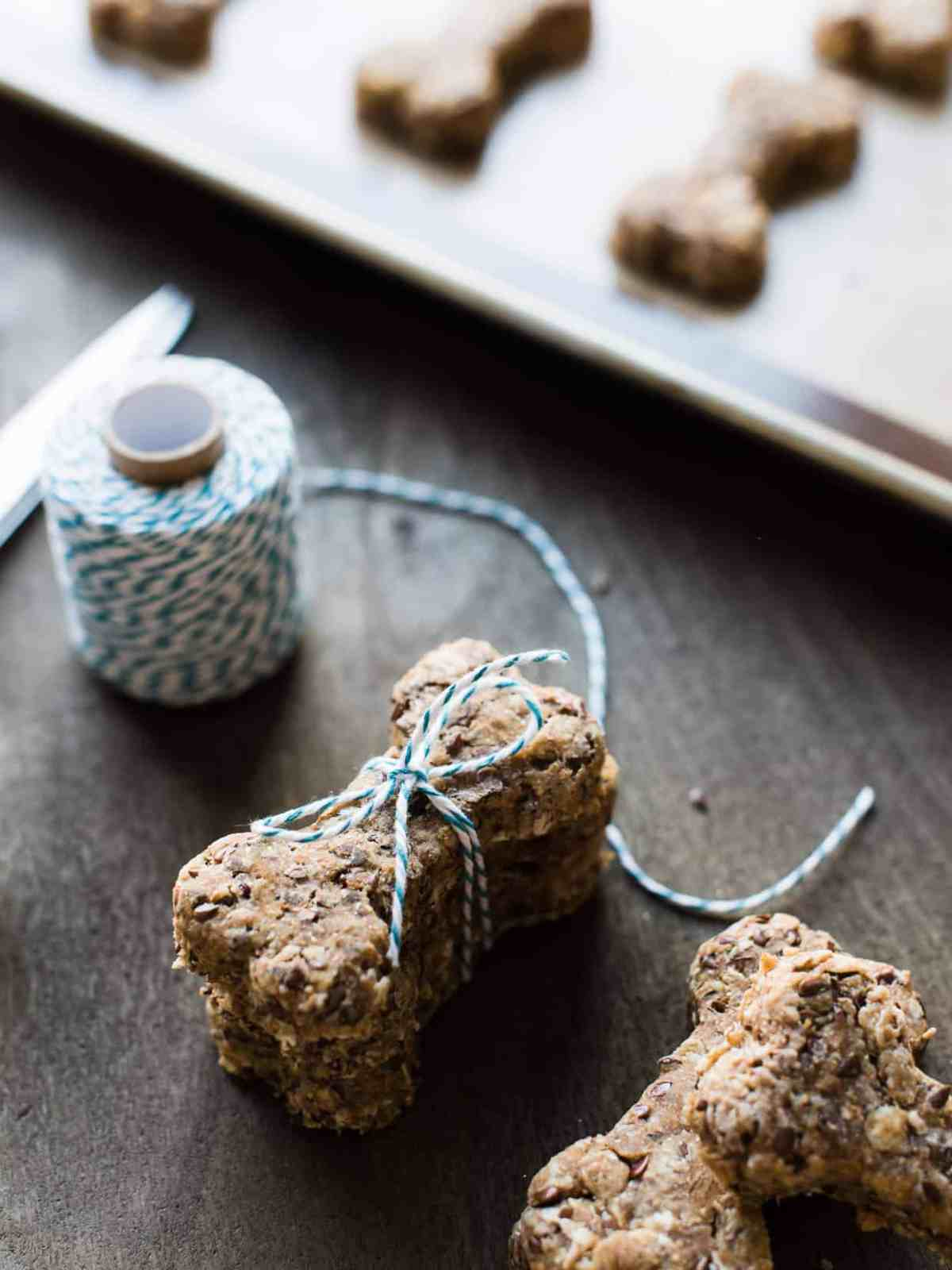 Packaging homemade dog biscuits with twine.