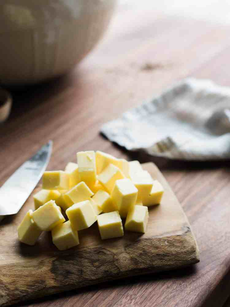 cubes of butter on a cutting board for Irish Soda Bread.