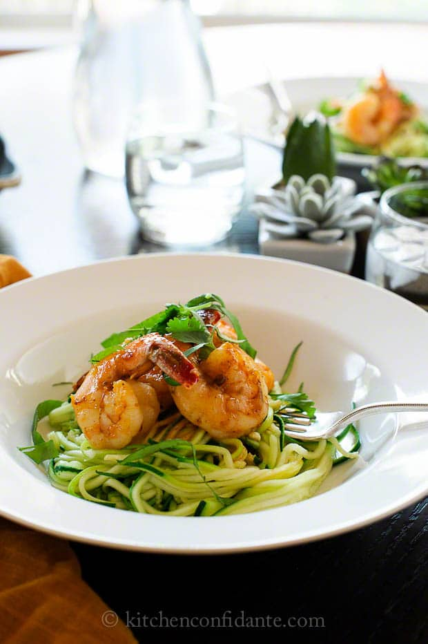 Spicy and satisfying, the Asian-style shrimp spiked with sriracha pairs well with healthy ribbons of zucchini noodles. When zucchini is abundant, it makes for a perfect summer meal.