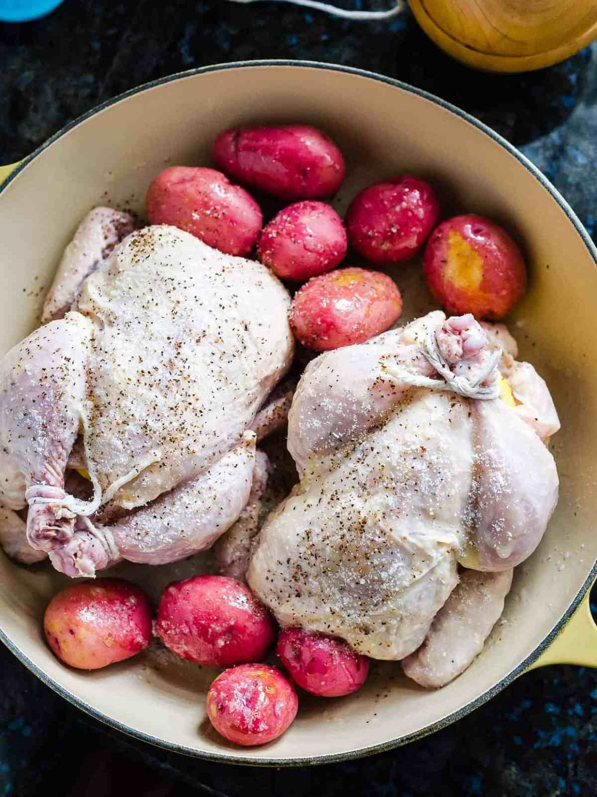 Prepped Buttermilk Brined Cornish Hens with potatoes ready for oven.
