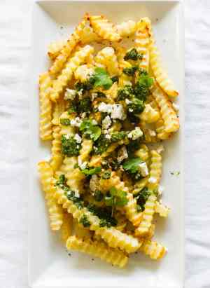 Chimichurri Fries with Queso Fresco | www.kitchenconfidante.com | Dress your fries in a bold chimichurri for the perfect savory snack