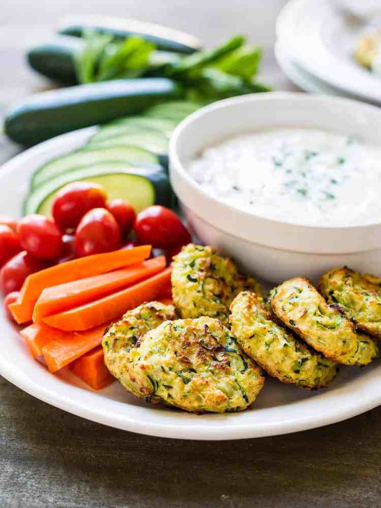 Baked Zucchini Fritters with Tzatziki are a great way to eat your veggies!