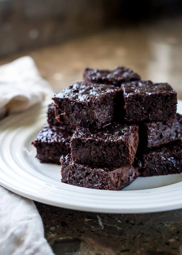 A stack of Zucchini Banana Brownies on a plate.