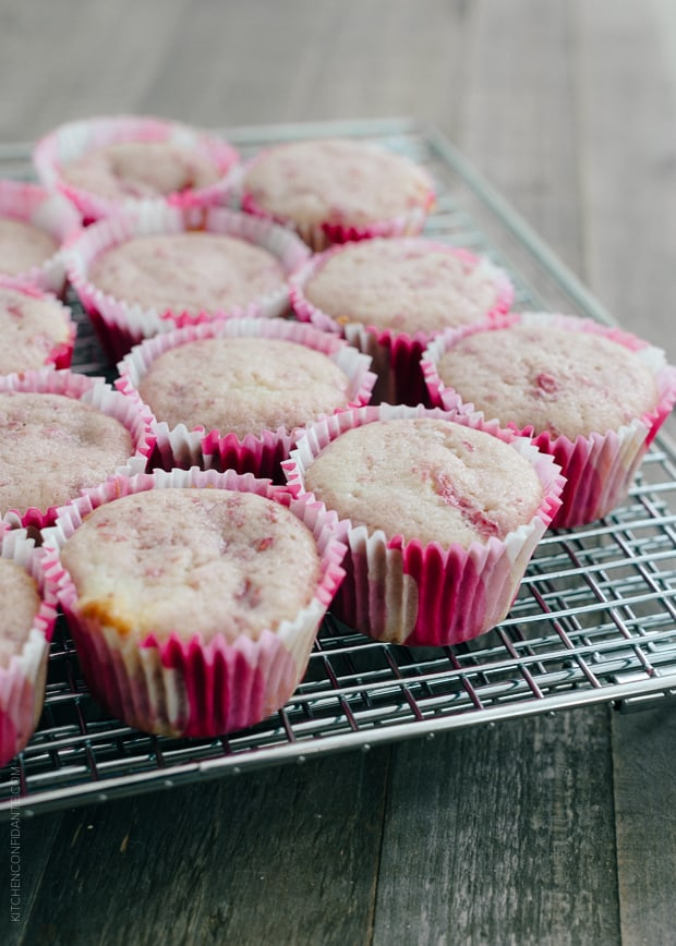 Roasted Berry Cupcakes on a cooling rack.