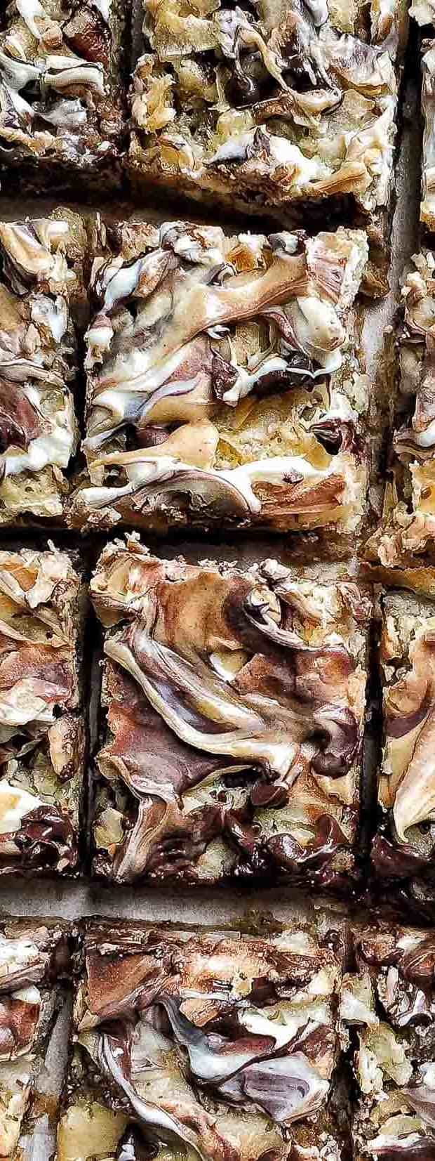 Close up view of freshly baked 7 Layer Bars cut into rectangles.