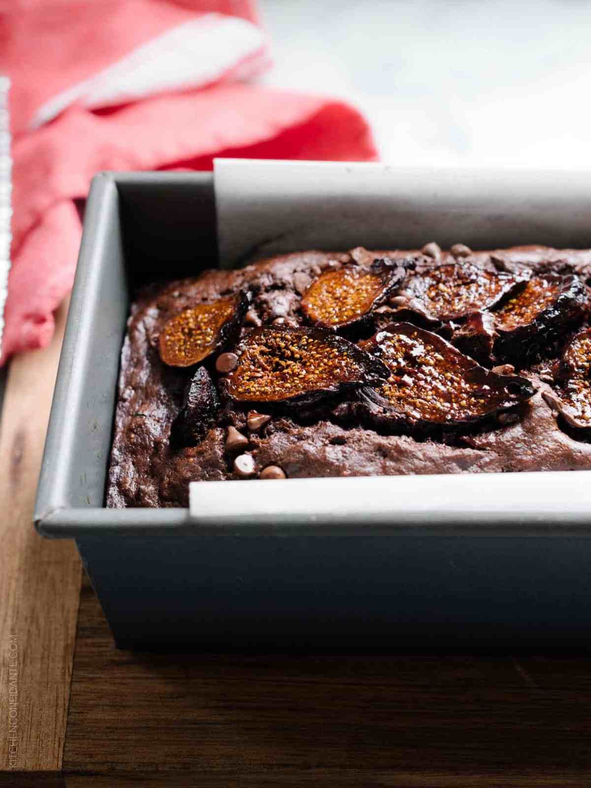 Dark and sweet Chocolate Banana Fig Bread in a loaf pan.