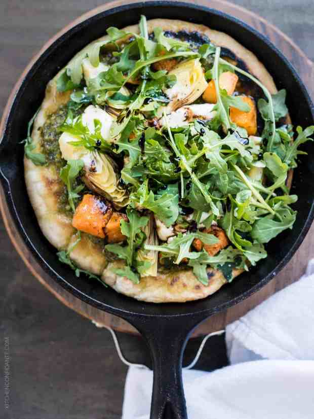 Who says you need an oven? This Skillet Pesto Flatbread with Goat Cheese, Artichokes and Roasted Butternut Squash made on the stovetop will surprise you!