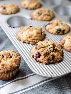 Bakery Style Buttermilk Blueberry Muffins in a muffin tin.