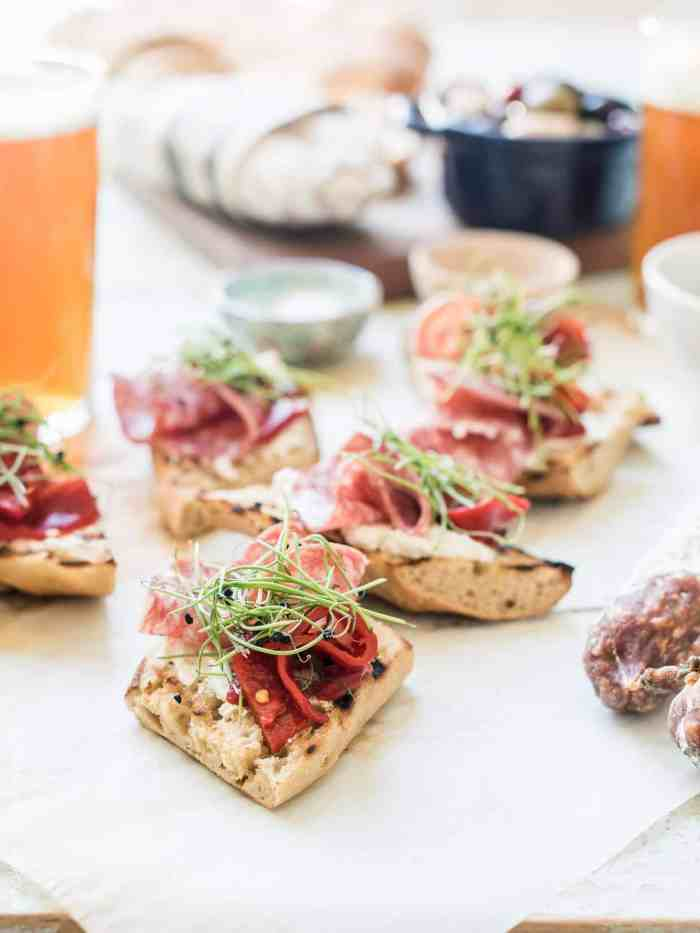 Several slices of Beer Bread Bruschetta with Salami.