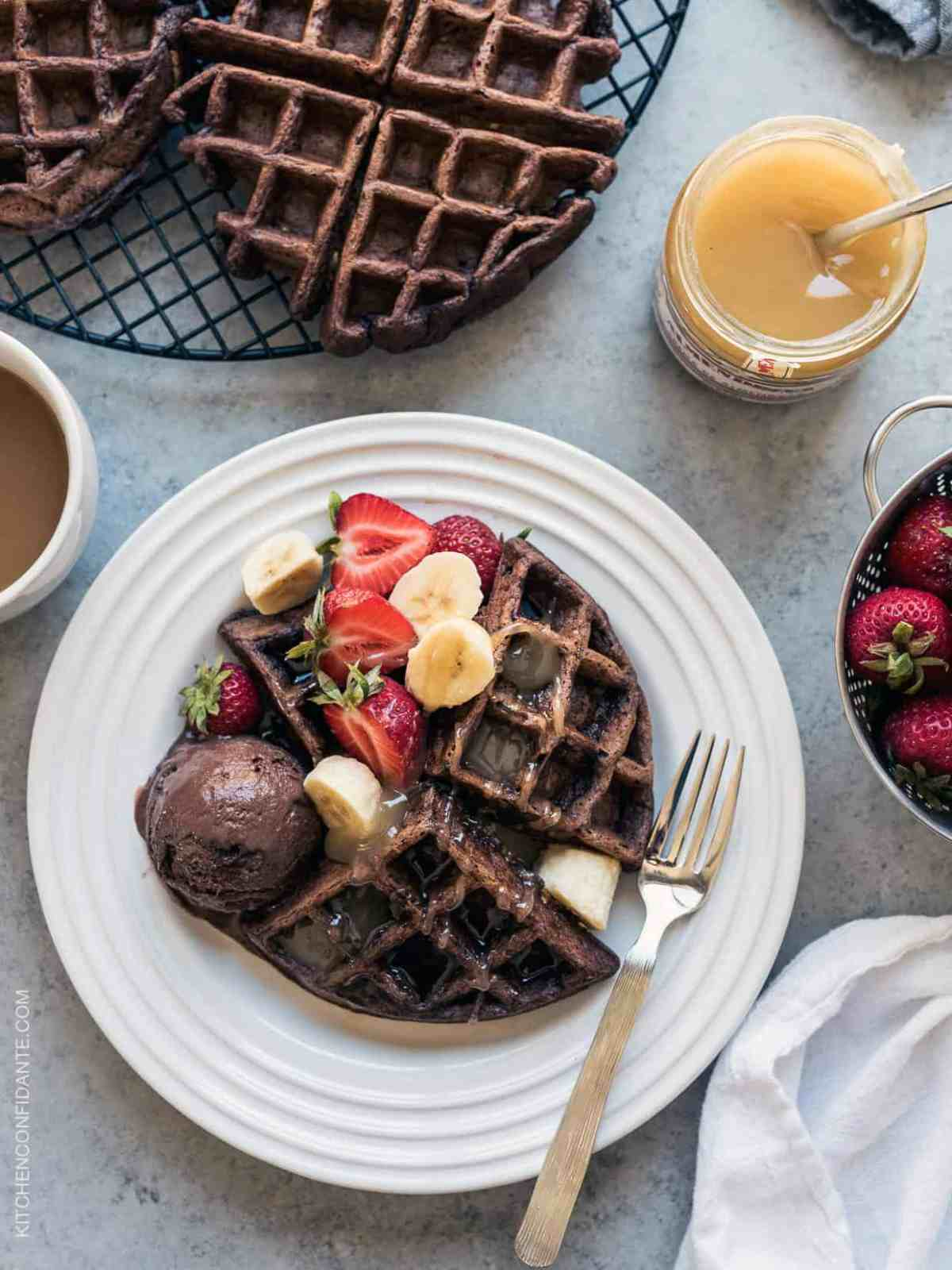 Chocolate Zucchini Belgian Waffles - hidden in the nooks and crannies are good-for-you zucchini! Use up summer zucchini in a chocolatey breakfast (or decadent dessert!)