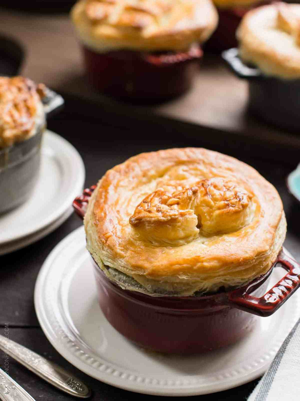 Turkey Pumpkin Pot Pie topped with a thick crust of golden-brown puff pastry.