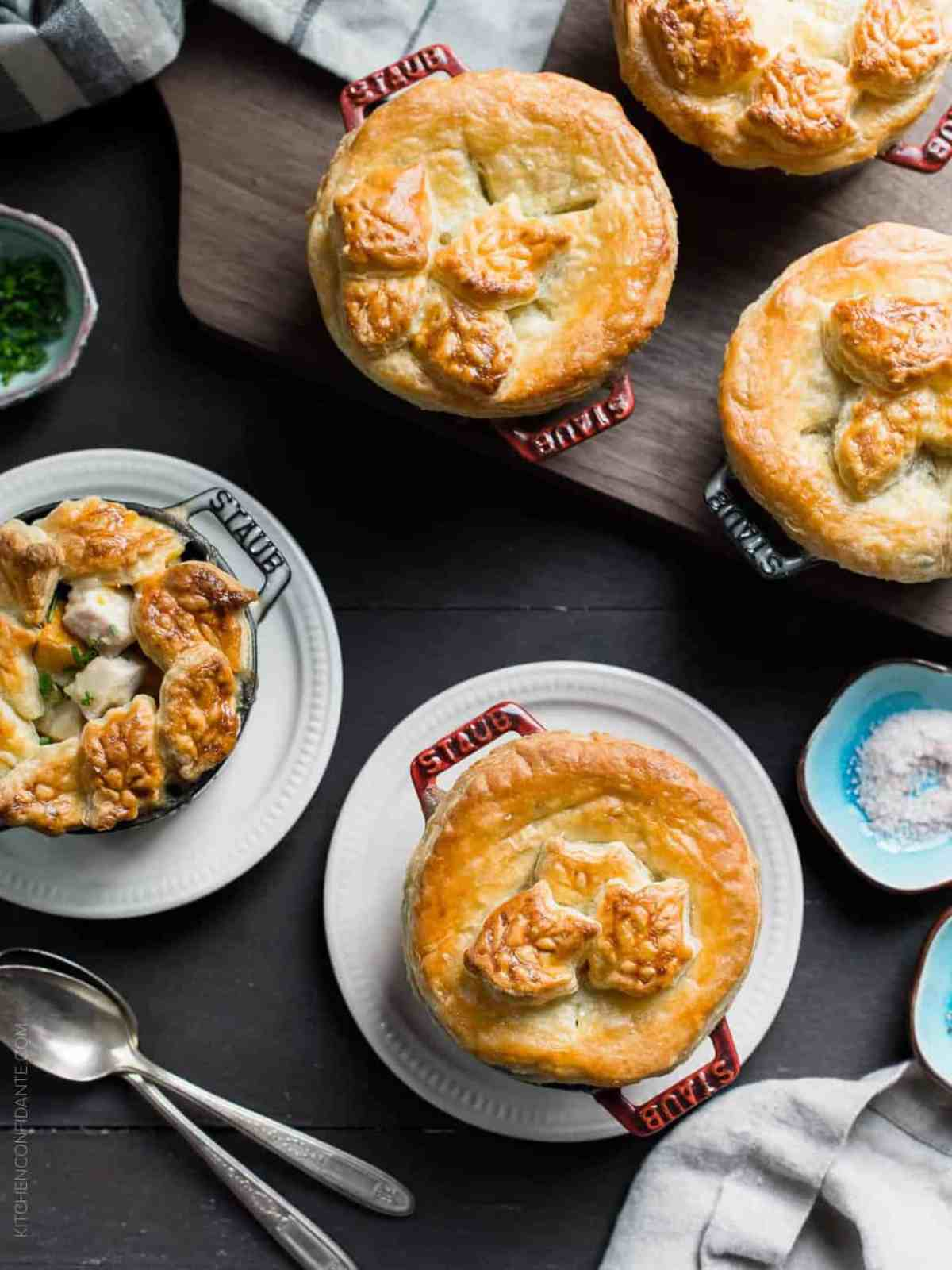 Turkey Pumpkin Pot Pies in single serving ramekins topped with golden-brown puff pastry.