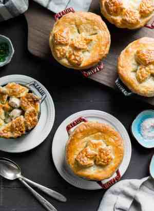 Turkey Pumpkin Pot Pies baked in single serving Dutch ovens and topped with a golden-brown puff pastry crust.
