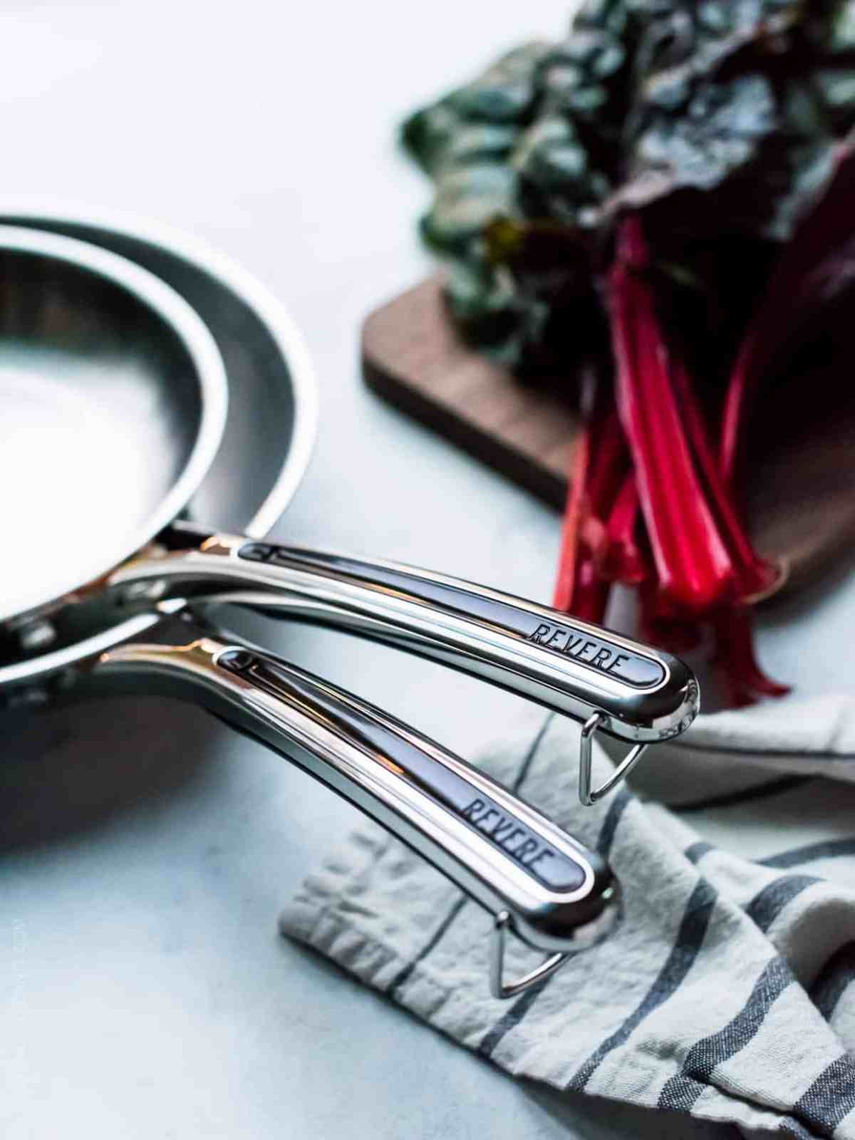 Close up view of Revere Cookware interlocking handles.