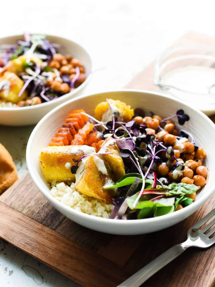 Hearty and healthy Plantain Buddha Bowl is full of nutrient rich foods that satisfy and nourish with protein and fiber rich plantains, chickpeas and greens.