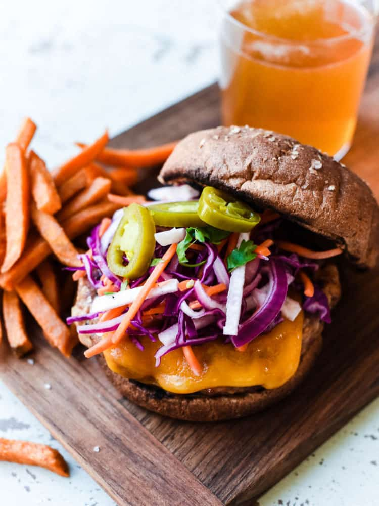 Get ready for your new favorite burger - Filipino-style Adobo Burgers are marinated for extra flavor! Try it topped with a red cabbage and jicama slaw for the ultimate burger bite!