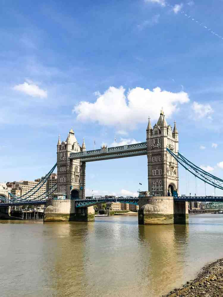 Tower Bridge in London with blue skies and the River Thames.