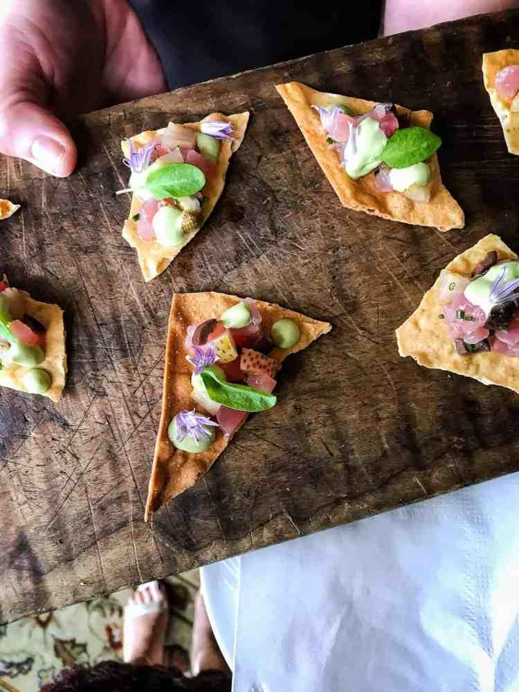 Tuna Tartare on wonton crisps served on a wooden board at the Pebble Beach Food & Wine.