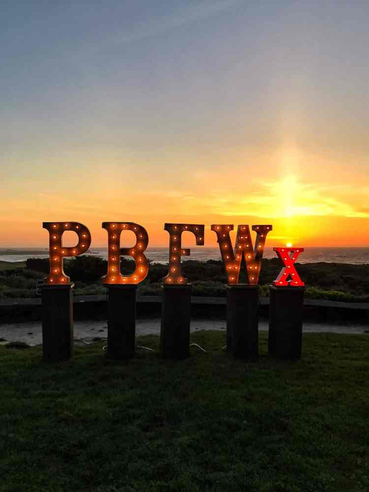 PBFWx sign at sunset at the Pebble Beach Food & Wine.