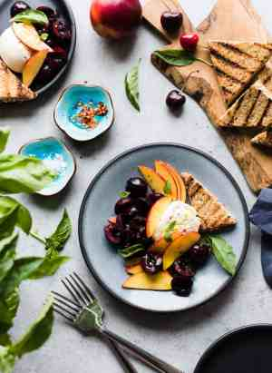 Summer stone fruit, fresh basil, and creamy burrata dressed in a zingy balsamic vinegar and olive oil is the perfect summer appetizer!