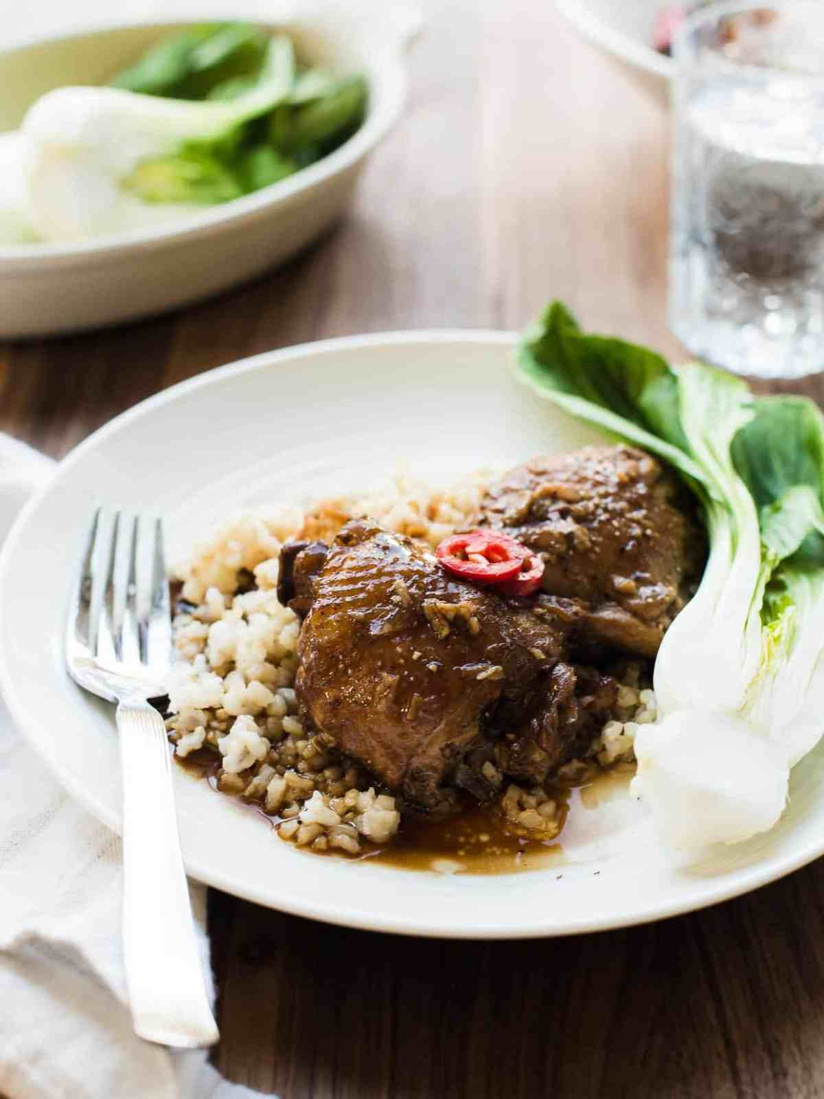 Plate of Filipino Chicken Adobo served over rice - the ultimate comfort food.