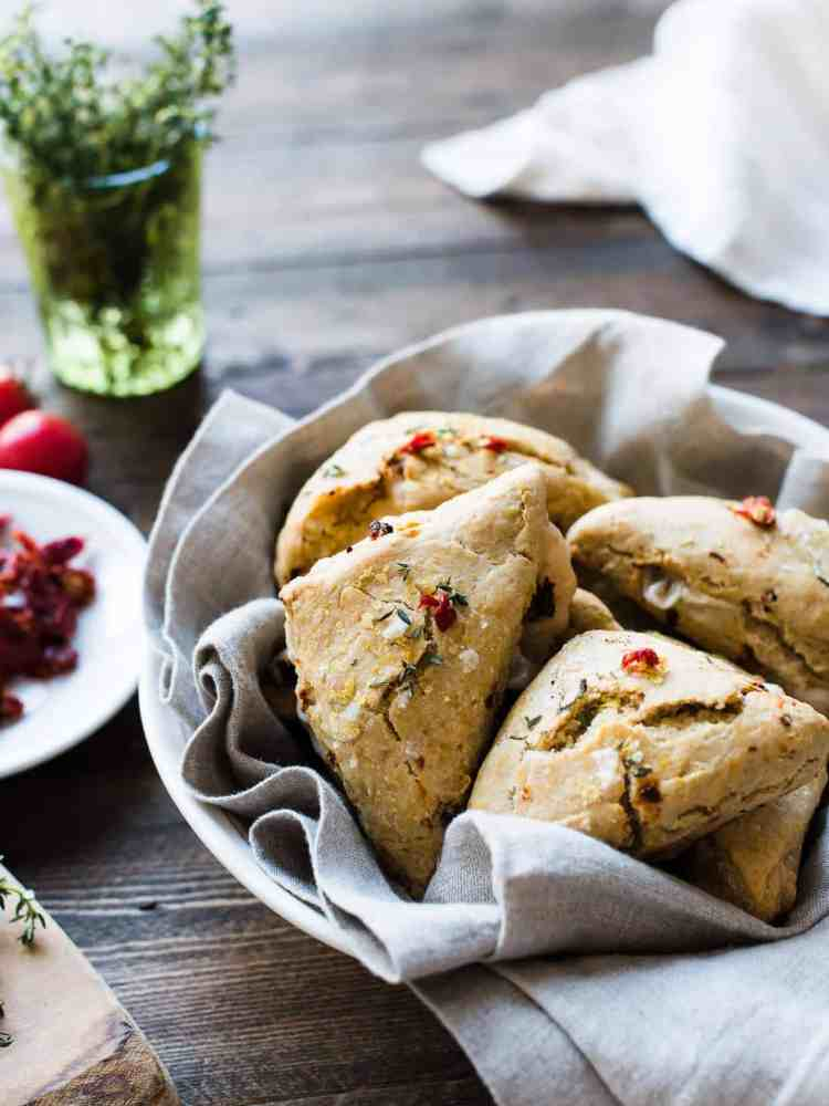 Sun-dried Tomato and Thyme Scones in a bowl with a cloth napkin.