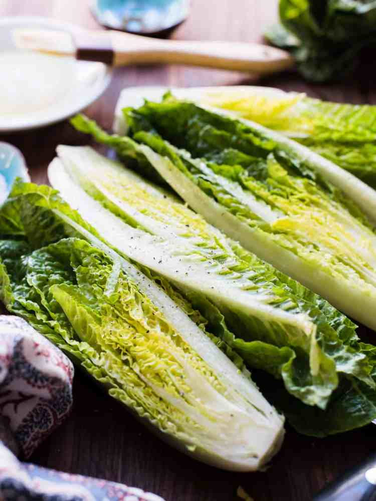 Halves of romaine for Grilled Romaine Green Goddess Salad.