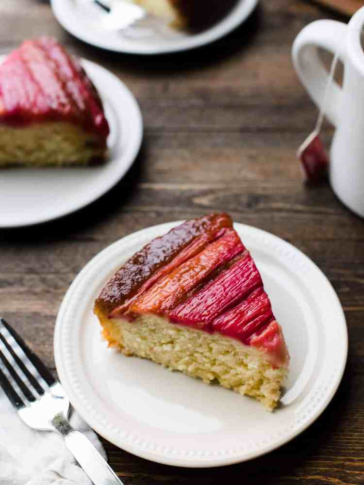 Slices of Rhubarb Upside-Down Cake on brown table.