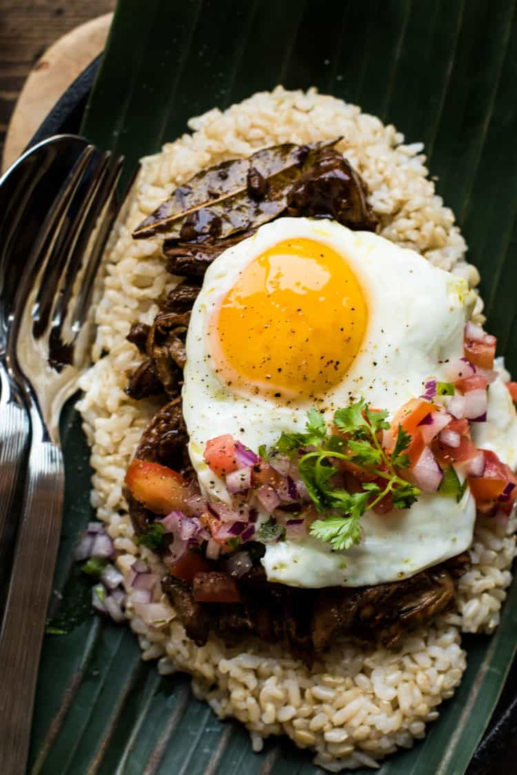 Shredded chicken adobo loco moco with egg and rice.