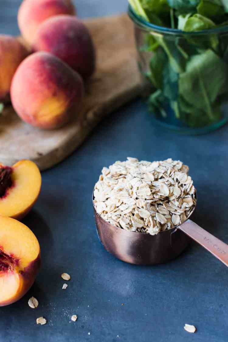 Oatmeal in a measuring cup for Peaches and Cream Green Breakfast Smoothie