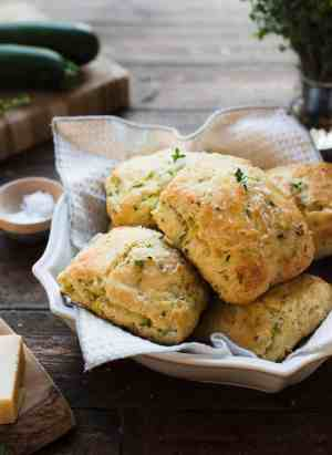 Savory Zucchini Scones with Feta and Thyme in a serving platter on a wood table.
