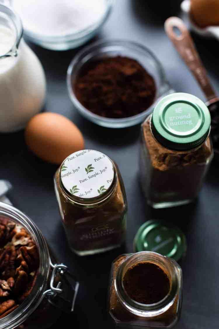 Tops of Simply Organic spice jars.